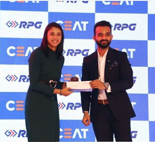 Smriti receiving the 'International Women Cricketer of the year 2019' award